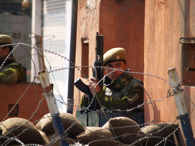 An Indian soldier warily eyes protesters in Srinagar, Kashmir. Credit: ©2007Derek Henry Flood