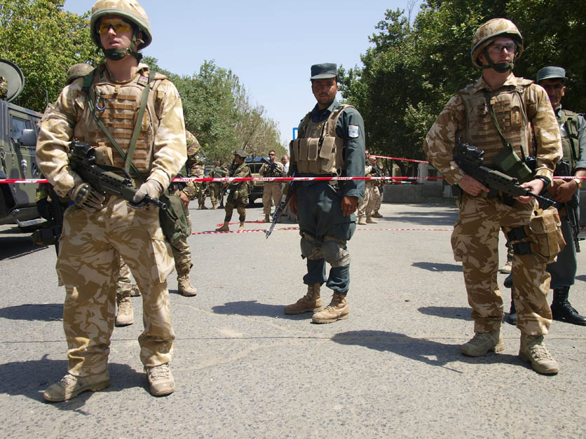 British and Afghan security forces hold the line after suicide attack rocked ISAF Headquarters in Kabul. ©2009 Derek Henry Flood.