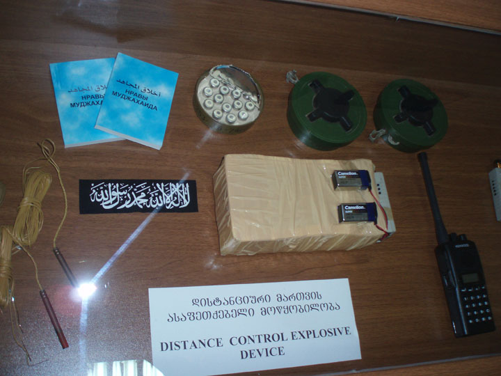 An assortment of goodies including jihadi literature in Cyrillic script, anti-personnel mines and an IED. ©2009 DHF