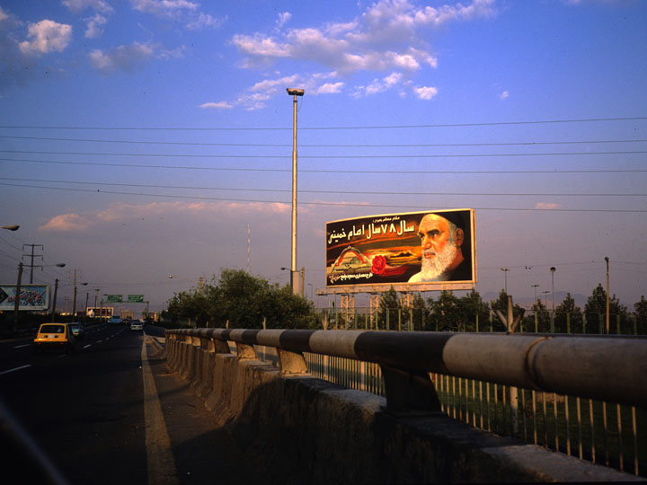 I arrived in Iran just 10 years after Khomeini's mass funeral and his clichéd glowering visage was everywhere. Whereas in California such public space would be adorned with images aimed a crass consumer society, in Iran, a white beard who barely smiled extolled the virtues of sacrifice and martyrdom within the bounds of his own sculpted Shia context. ©1999 Derek Henry Floo