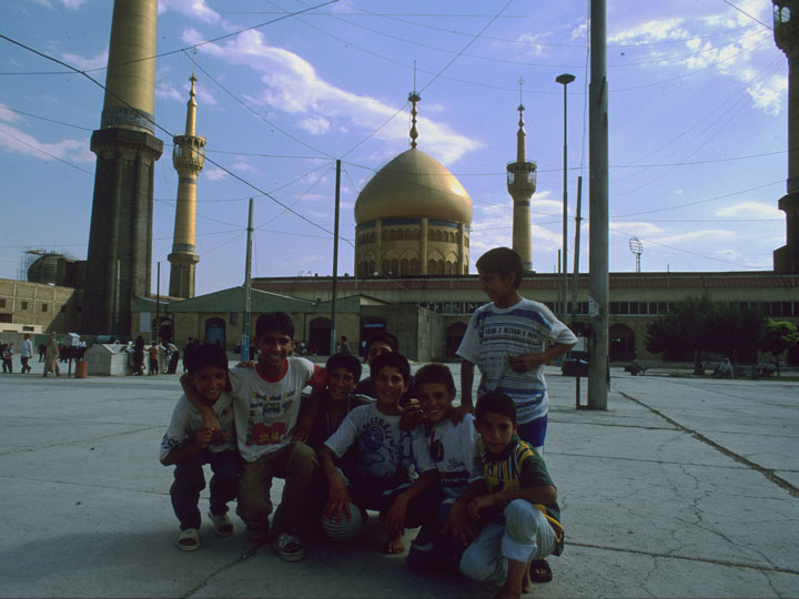 A group of boys jubilantly pose in the courtyard of  Khomeini's elaborate mausoleum set within the Behesht-e Zahra cemetery complex. ©1999 Derek Henry Flood