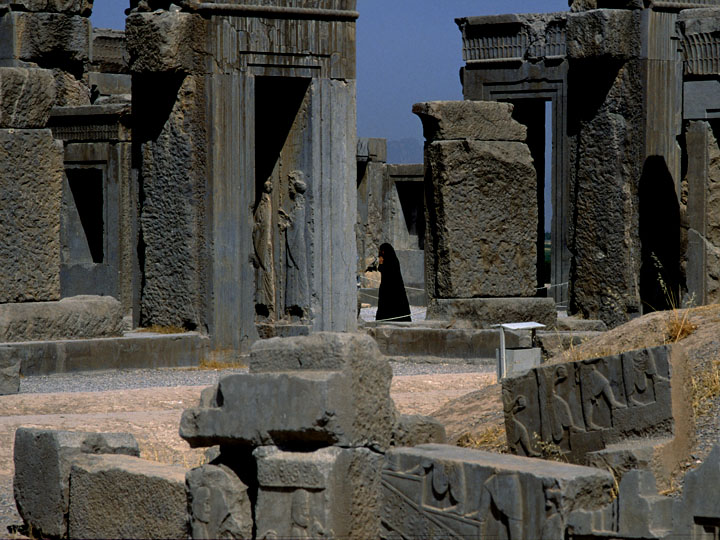 What non-political pictorial on Iran would be complete without an image of the storied Persepolis? A chador-cloaked woman saunters through to ruined columns of the ancient Achaemenid capital in Fars Province.   The über decadent party held here by Shah Reza Pahlavi in October 1971 to celebrate Cyrus the Great's founding of the Persian monarchy 2500 years previously is thought by some have been one of the initial sparks of the Shah's undoing. The SAVAK-supervised four-day event rankled a then relatively obscure ayatollah exiled in Najaf, Iraq named Ruhollah Khomeini who was infuriated by the whole affair. ©1999 Derek Henry Flood