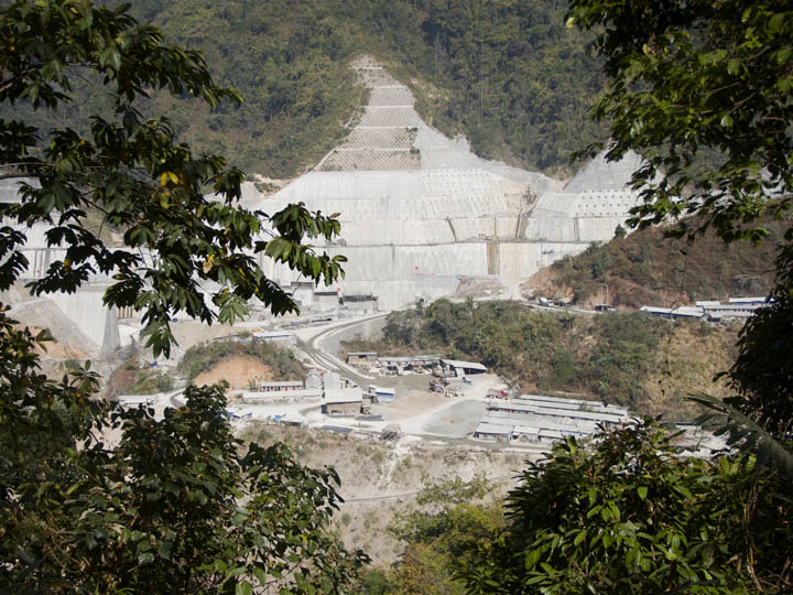 Chinese dam While the fight rages in Kachin State work continues unabated on the Chinese dam that has been a hot bed of contention between the Burmese and the Kachin people. The power generated by this dam will go straight back to China. If the Kachin want access to the power produced by the dam they will have to buy it from the Chinese. Oddly enough the Burmese Military and Civilian Government don't seem to care that their land is being exploited by another country as long as they get paid. ©2013 Raymond Pagnucco