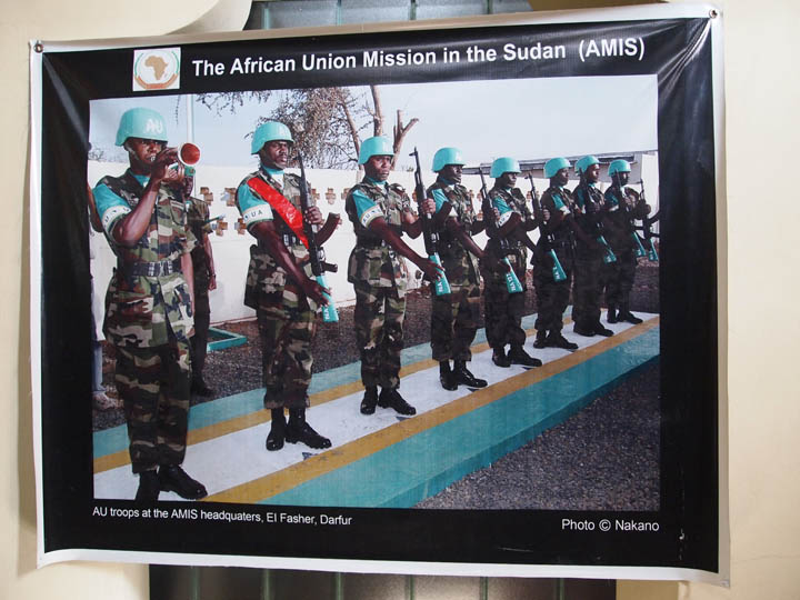 A poster promoting the AU's peacekeeping mission in Darfur, Sudan. ©2011 Derek Henry Flod