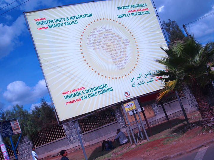 An African Union billboard outside the AU headquarters in Addis Ababa, Ethiopia featuring the four main languages of the international body- Arabic, English, French, and Portuguese. ©2011 Derek Henry Flood