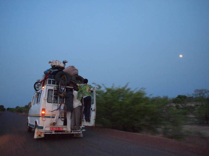 A Sotrama (shared minibus) makes its way toward Mopti in central Mali. ©2012 Derek Henry Flood