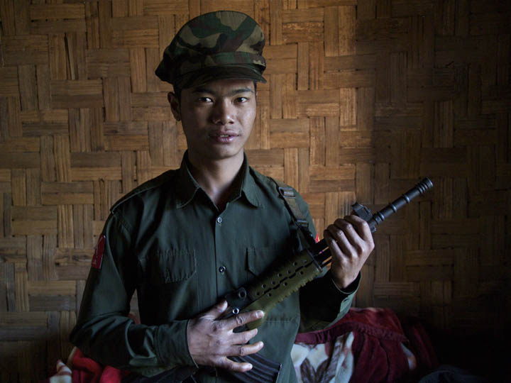 KIA soldier with Gun ( this can be used with either pic) Young Kachin Soldier posses with this rifle. This rifle is Kachin made copy of the Chinese Type 81. The Kachin make a lot of their weapons including claymore, grenades, mortar rounds and bullets. I asked one KIA official why they didn't buy weapons from China. He replied we didn't want to make the Burmese Military mad and we never thought we would be fighting again. So we put our resources in to building a civil society and infrastructure. ©2013 Raymond Pagnucco