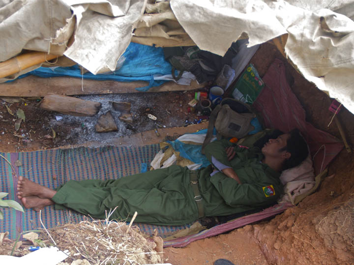 KIA soldier sleeps in trench  After a long night of guard duty a KIA solder sleeps in a trench. This picture was take at the front lines in Laiza. Three weeks earlier this was a rear position now it's the front. I stood over this young man while he slept and tried to imagine what this young man when through in the last few weeks. ©2013 Raymond Pagnucco