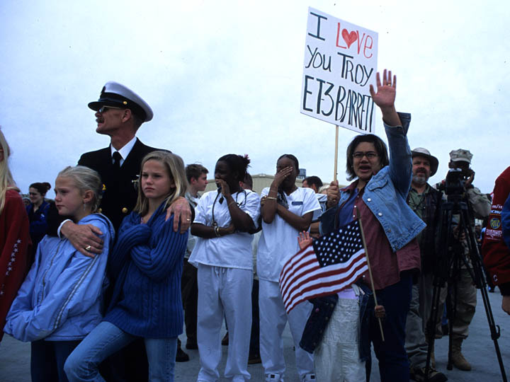 Families big adieu to the USS Nimitz-nuclear-powered aircraft carrier-as it heads to the Arabian Sea and Persian Gulf region on March 3, 2003 in preparation for Operation Enduring Freedom. ©2003 Derek Henry Flood