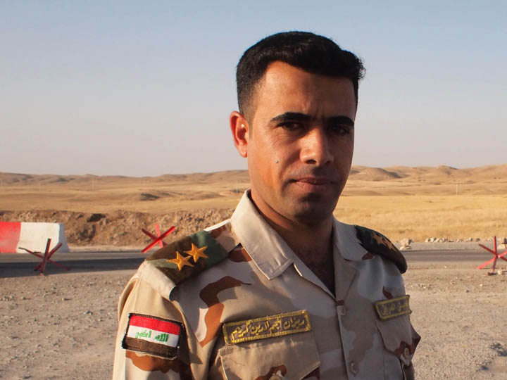 An Iraqi Army officer would allow me to shoot a few photos but was hesitant to give a formal interview without approval through the proper chain of command. ©2013 Derek Henry Flood