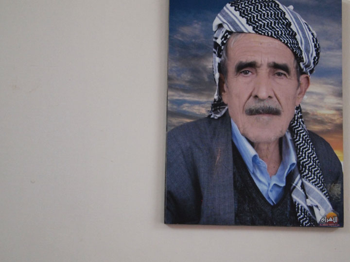 A portrait of Wahab Mohammed Sharir, a Kurdish martyr portrait in my fixer's living room in Kirkuk. ©2013 Derek Henry Flood