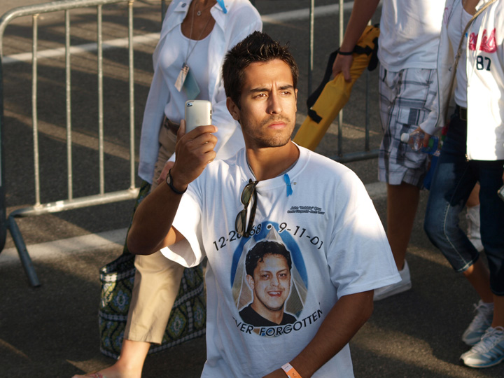 Families arrive en masse to the site of the former World Trade Center to grieve once more for the 10th anniversary of the 9/11 terrorist attacks. The attacks claimed victims from across New York's incredibly diverse ethnic and religious communities. Many of the families had t shirts created in honour of their loved ones.