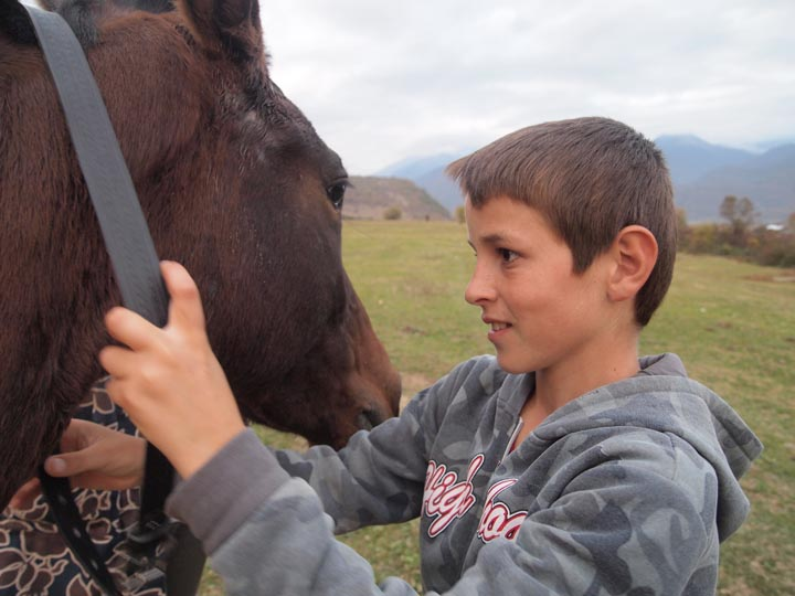 A boy and his horse between Duisi and Jokolo. ©2013 Derek Henry Flood