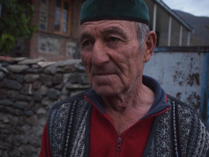An effusive Chechen elder I met at sundown in the village of Birkiani. What a cool guy! A random Westerner shows up at his gate and he immediately offers warm, old school Chechen hospitality. ©2013 Derek Henry Flood