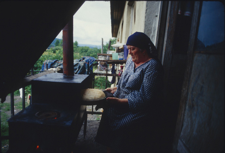 Murad took me to meet this Kist woman in Duisi who was baking bread for the Chechen refugees that had sought safety there. ©2002 Derek Henry Flood
