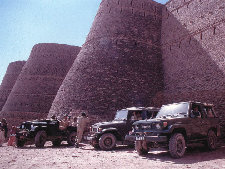 Pakistani army soldiers parked in front of the hulking bastions of the Derawar Fort in the searingly hot Cholistan Desert in Punjab. ©2000 Derek Henry Flood