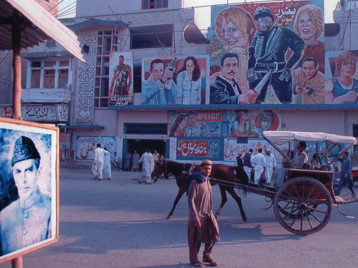 A movie theatre in Peshawar, Pakistan with South Asian-style hand painted film posters. The poster on the far left depicts Russell Crowe in Ridley Scott's Gladiator which was still a fairly recent release at that time. In the centre appears to be a Planet of the Apes poster. ©2000 Derek Henry Flood