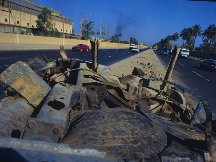 Although the Americans wouldn't yet admit an insurrection against the US-led occupation was already underway from the war's inception, it was pretty obvious walking around Baghdad that things were going to get ugly. Here, I found the upside down chassis of a what appeared to be a car bomb. ©2003 Derek Henry Flood