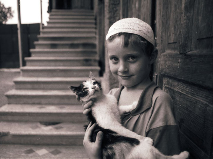 Ismail with his scruffy cat in the village of Birkiani. ©2002 Derek Henry Flood