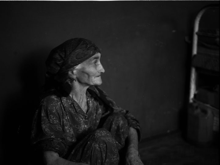 An elderly refugee from southern Chechnya's Itum-Kale district sits in the home of a Kist host family in Duisi, Georgia. ©2002 Derek Henry Flood
