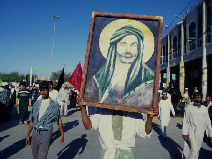A man carries a painting of Imam Hussein during a procession commemorating Milad un Nabi (the birthday of Prophet Muhammed). ©2003 Derek Henry Flood