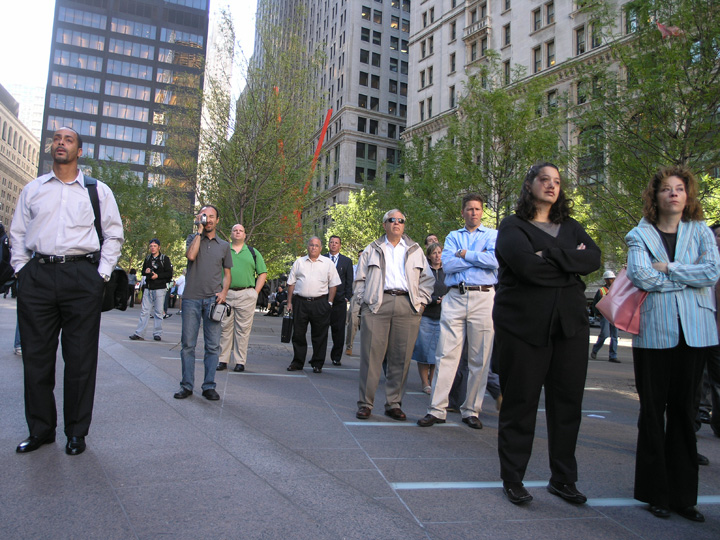 People observe a moment of silence in remembrance of the 5 year anniversary of the 9/11 terror attacks at the former site of the World Trade Center in Manhattan. ©2006 Derek Henry Flood