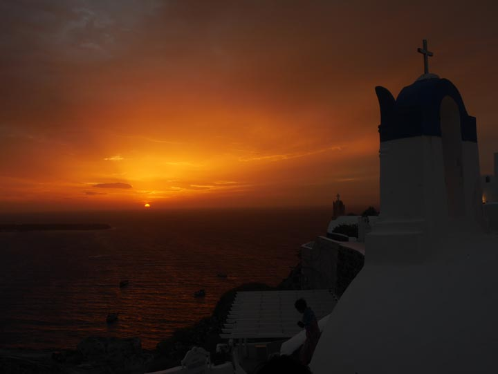 A typical sunset as seen from Oia. ©2014 Derek Henry Flood