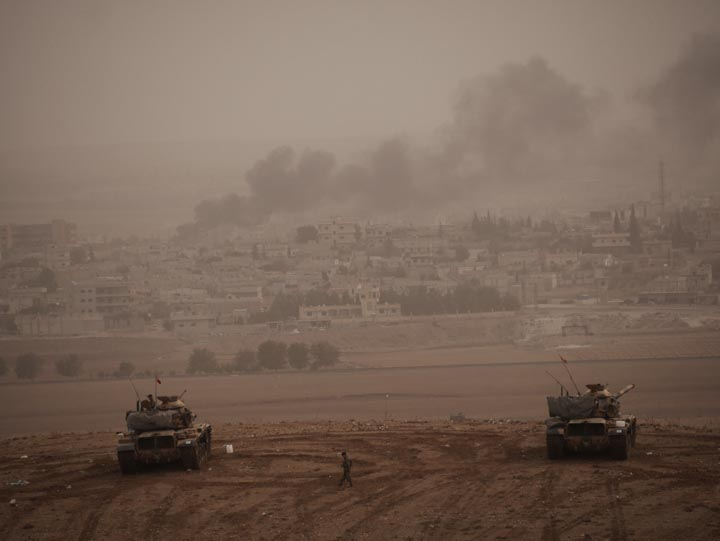Turkish tank position on a hill overlooking Kobane, Syria. ©2014 Derek Henry Flood