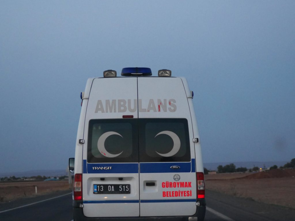 Ambulances are a far too common sight on these Orwellian road trips. ©2014 Derek Henry Flood