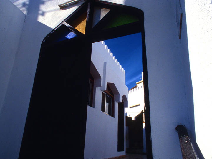 An elegant doorway on a quiet backstreet in Msucat, Oman. ©2000 Derek Henry Flood