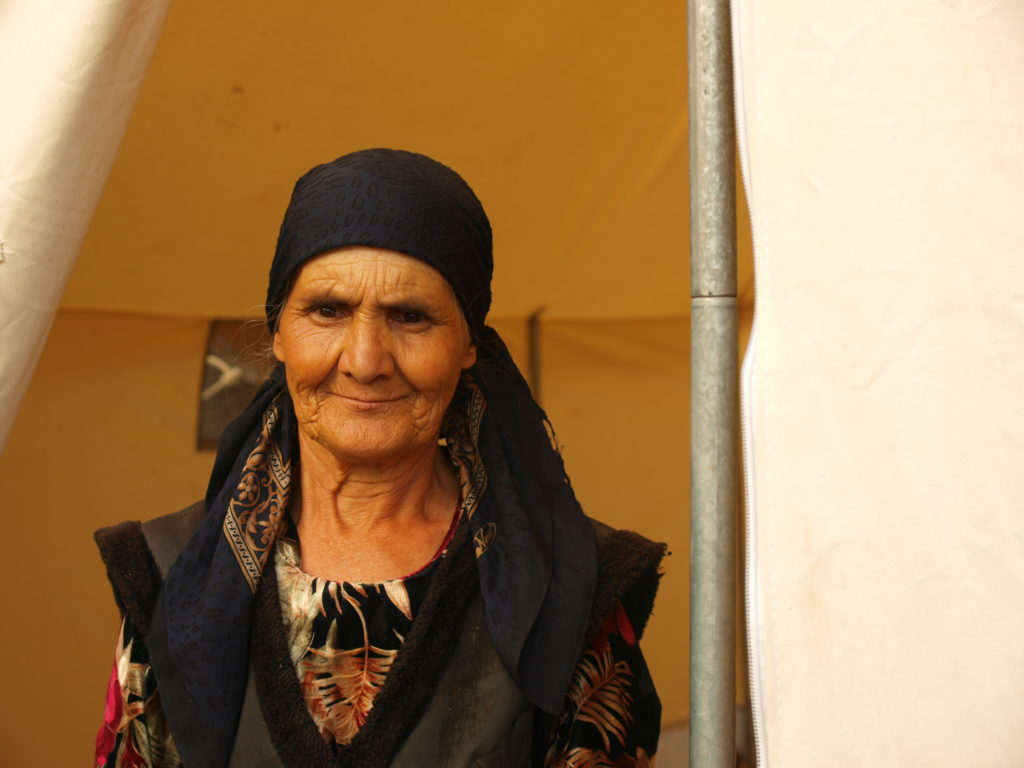 An ethnic-Uzbek woman living in a Turkish Red Crescent tent on the ground where her home had stood. ©2010 Derek Henry Flood