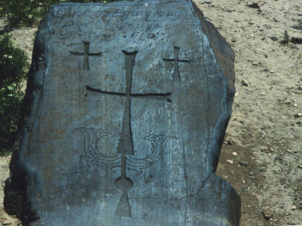 An ancient Armenian tombstone in the fields surrounding Mt. Ararat. ©1999 Derek Henry Flood