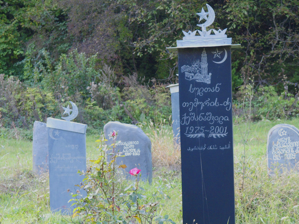 A Kist graveyard near the village of Birkiani in Georgia's Pankisi Gorge. Note the central tombstone is engraved in Georgian and Arabic script but absent is Cyrillic. Several prominent jihadi leaders operating in Syria hail from this string of villages along the Alazani River in northeastern Georgia.This once quiet post-Soviet backwater has aroused all sorts of intrigue for years now yet it remains poorly understood. ©2009 Derek Henry Flood