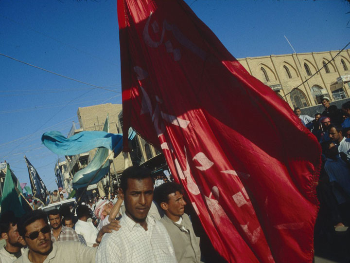 A procession organized by the hazwa (Shia clerical body) outside the shrine complex of Imam Ali in Najaf. ©2003 Derek Henry Flood