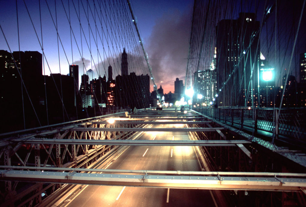 Ruins of twin towers smoking as seen from the Brooklyn Bridge on 9/12/2001. ©2001 Derek Henry Flood