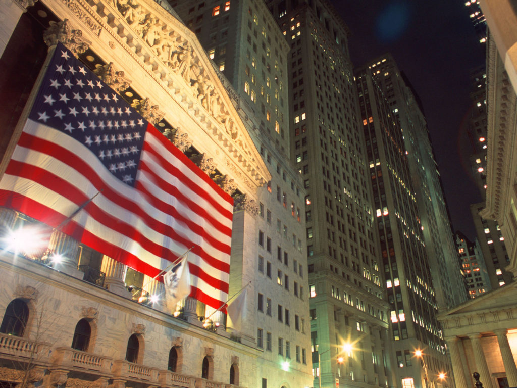 On the six month anniversary of 9/11 the New York Stock Exchange is draped in a massive American flag. ©2002 Derek Henry Flood
