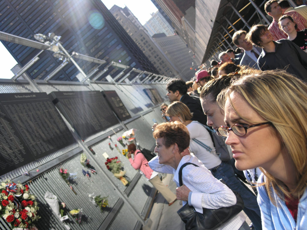 People gather in remembrance of the 5 year anniversary of the 9/11 terror attacks at the former site of the World Trade Center in Manhattan.
