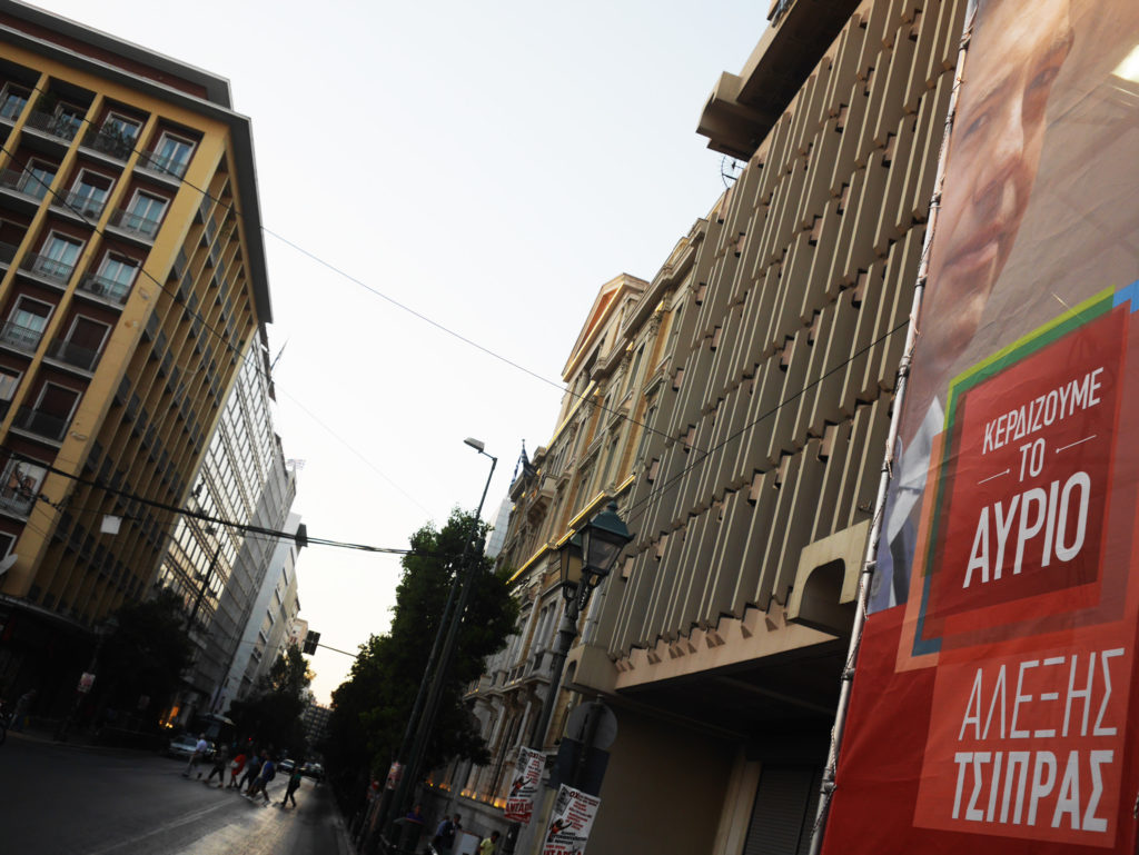 A giant banner of former PM Alexis Tsipiras hangs at dusk in downtown Athens. braces for snap parliamentary election on Sunday amidst the debt and migrant crises. The elections will then lead to the selection of a new Prime Minister following the resgination of former Greek Prime Minister Alexis Tsipras in August.