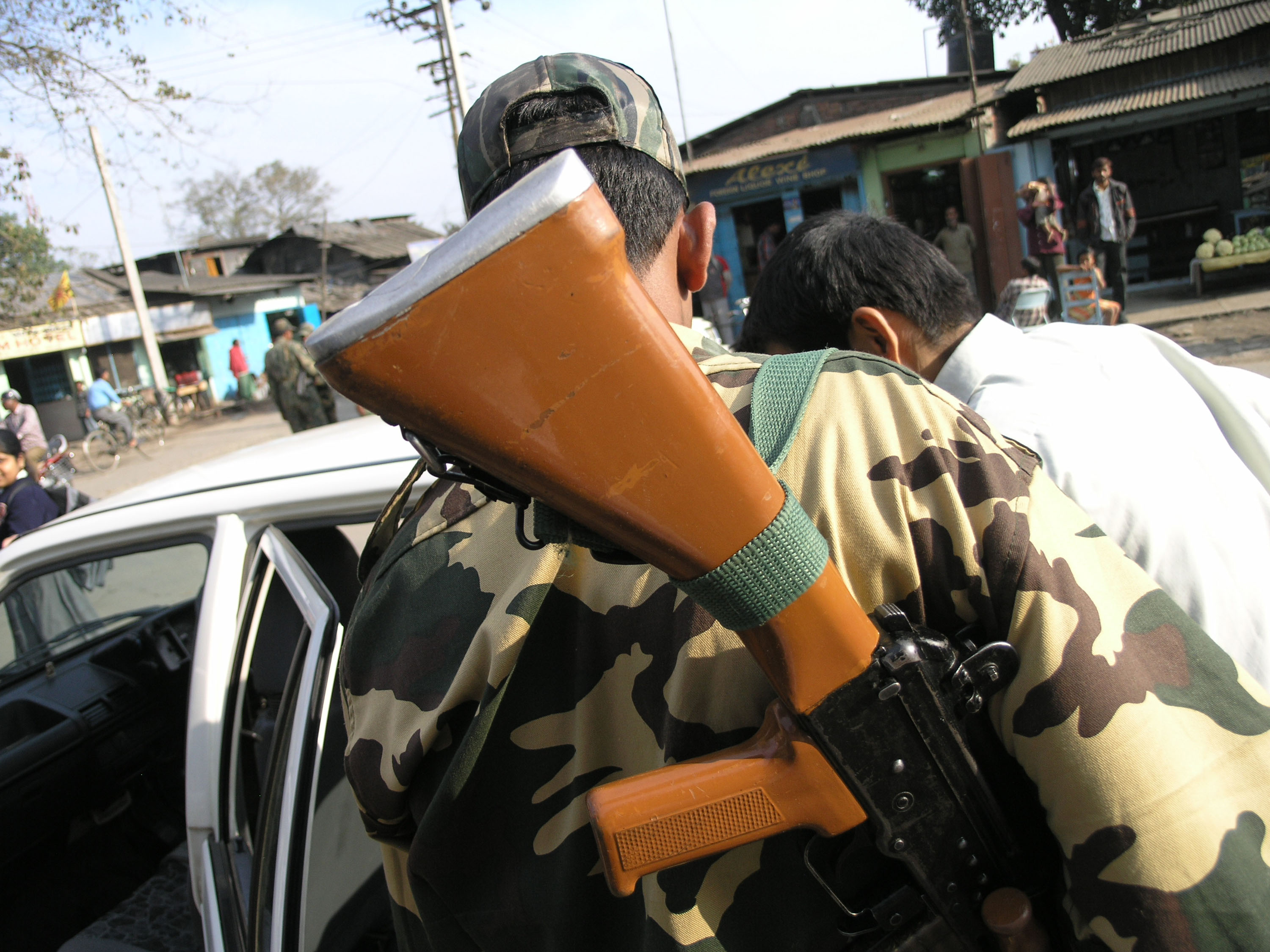 Getting our car searched for weapons in Tinsukia in upper Assam with the insurgency raging at the time. ©2007 Derek Henry Flood