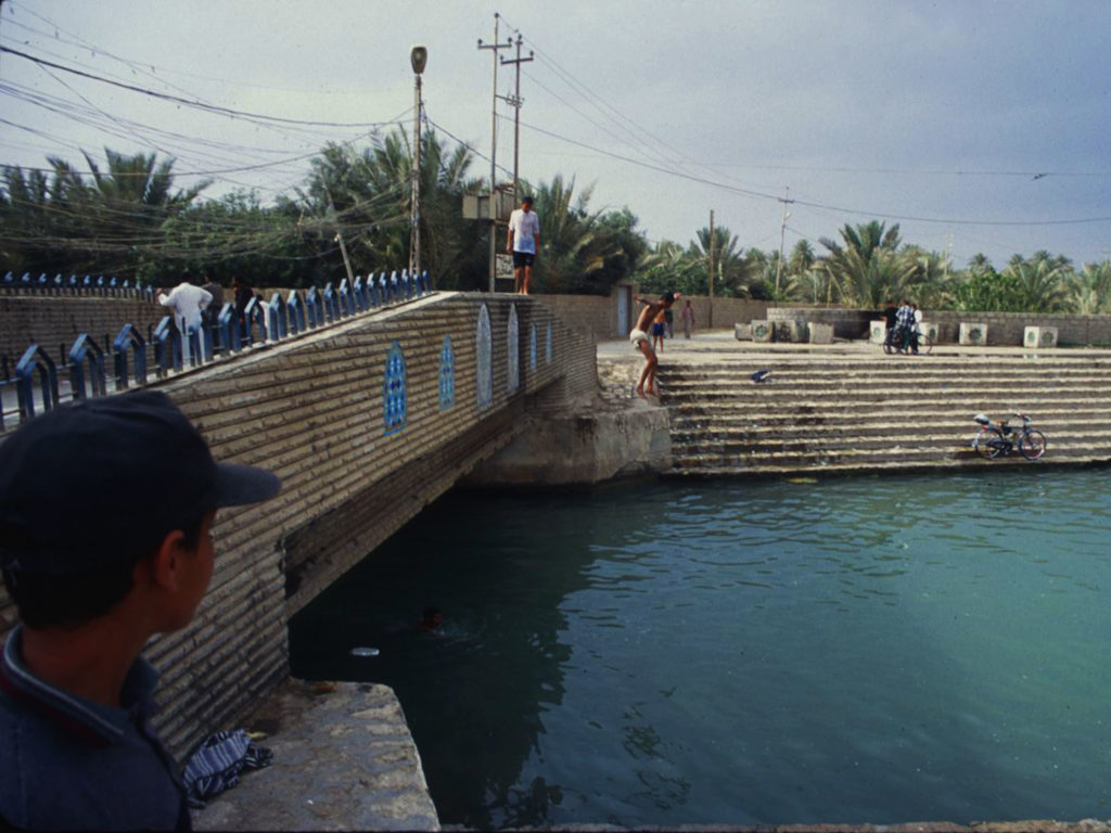 Boys hurl themselves into the Euphrates River after the fall of the regime of then President Saddam Hussein. ©2003 Derek henry Flood