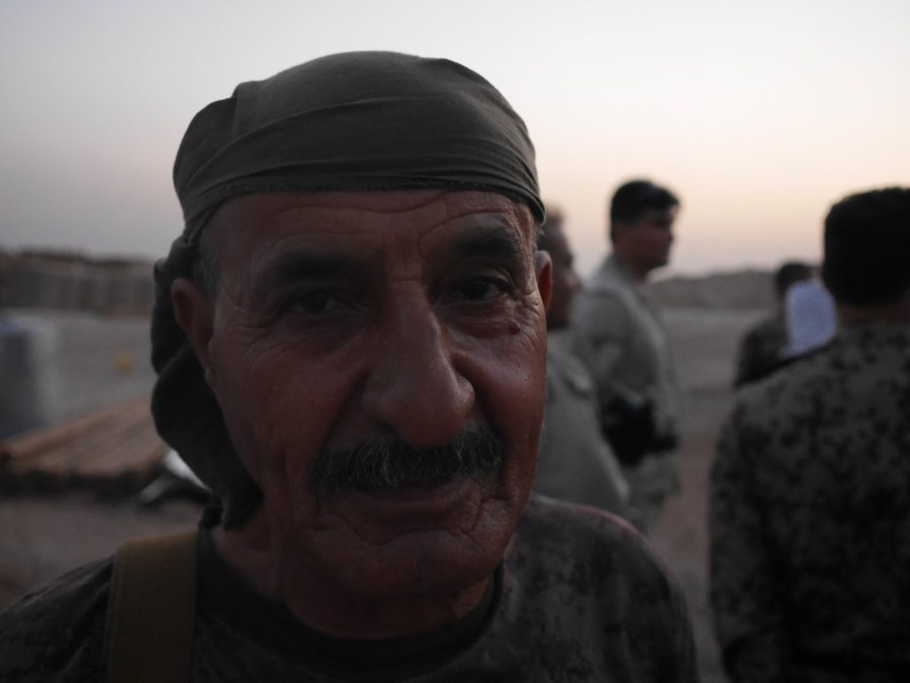 A veteran peshmerga volunteer pauses after the natural stress cause by an Islamic State attack, a minuscule incident in a life scarred by decades of on again, off again conflict. ©2016 Derek Henry Flood