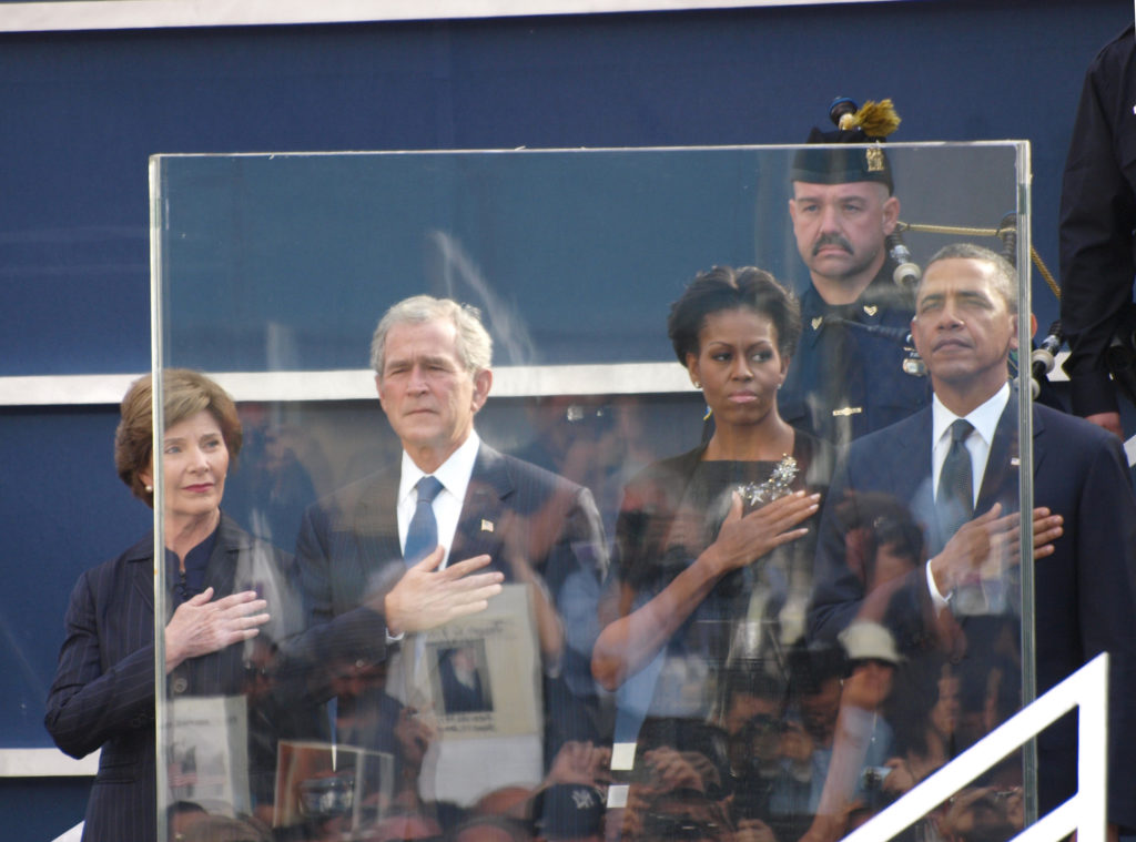 President Barack Obama First Lady Michelle Obama George W. Bush and Laura Bush attend the ceremony in Lower Manhattan to mark the 10th anniversary of 9/11. While the Obamas remained composed throughout the Bush's displayed visible signs of emotion as the events of 9/11 were recalled.